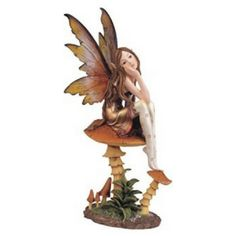 Pixie with Clear Wings. www.teeliesfairygarden.com . . . It's hard to deny that this pixie is a darling. While sitting on a mushroom, this pixie takes the time to contemplate and think about life. #pixie