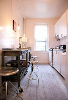 """""""Anne's East Village"""" kitchen, Designer: Christina Love     kitchen bar carts. I love the stain on that wood with the marble top, brushed aluminum of the seats and industrialness (+flexibility) of casters."""