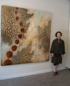 """Main gallery wall featuring """"Evolution"""" encaustic on 9 panels 72""""x 72""""  Gallery west wall view.    Artist, Mike Stilkey , creates an instal..."""
