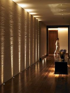 Create your own spa feel with this directional lighting that enhances the natural texture of the walls.