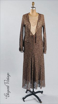 1920's French Lace Dress & Jacket. The lace is a warm milky chocolate, with an ivory bodice.  The dress is created mostly with the brown lace. The ivory tone bodice is set into the chocolate lace forming large V's. The dress has sleeves that just skim the upper arm. There is a narrow belt out of lace with a faux tortoise shell buckle and rhinestones.