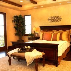 Bedroom Decorating Ideas - Decorating a Master Bedroom - Good Housekeeping.   i like that bed and the warmth of the room.  needs a lil sumpthin though.