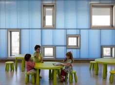 Escuela Infantil Pablo Neruda designed by Rueda Pizarro features custom designed scaled furniture and a variety of sized and scaled windows.