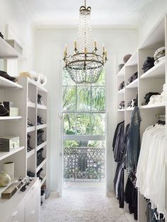 A clean, white modern french closet. An antique French chandelier hangs in the closet of a New Orleans house by Lee Ledbetter. Closet Designs and Dressing Room Ideas Photos | Architectural Digest