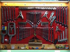 Organized to perfection! Close-up of Wall Control Red Metal Pegboard being used here in a custom pegboard cabinet. Customer Clark created a beautiful wooden hinged pegboard cabinet that can be opened and closed. A very creative, functional, and attractive use of Wall Control Metal Pegboard. Thanks for the great customer submission Clark!