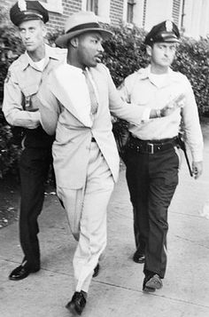 Martin Luther King, Jr. being arrested.