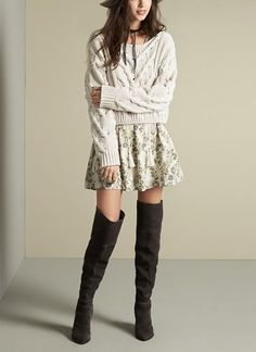 A cropped cable knit sweater is perfect for throwing over a flowy dress when the weather starts to get chilly. Add over-the-knee boots to complete this chic and feminine fall look.