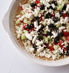 Five Layer Greek Dip (Hummus, Feta, tomatoes, olives, cucumbers)