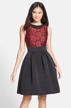 Free shipping and returns on Eliza J Embellished Jacquard Fit & Flare Dress (Regular & Petite) at Nordstrom.com. Dark, shimmering jewels grace the neckline of a rich jacquard bodice atop a festive cocktail dress. A textured, pleat-flared skirt completes the feminine look.