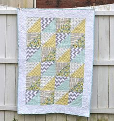 6 colors Quick: 3 grays, 1 yellow, 1 green, 1 gray/green/yellow  Triangles Baby Quilt
