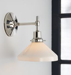 In the kids bath, I prefer a 2 light fixture like the first option, since we have a lot of wall width over the vanity.   This one is more expensive bc of the 2 lights...It's $236 on sale.  If you's feel more comfortable with the single light option at $160, we can do that.