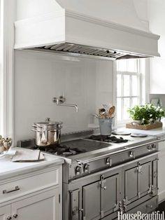 Stainless la Cornue Range, white cabinets