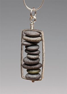 Stacked pebble necklace pendant. Requires drilling holes in the center of each small stone.