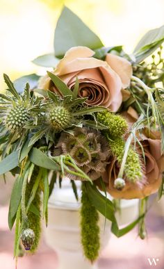 Natural color palette with soft whimsical touches. This floral arrangement is gorgeous for subtle touches of beauty.
