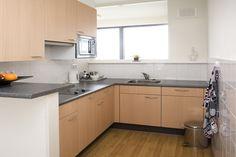 Een keuken in één van de appartementen van ECR De Keizershof.