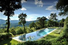 Outdoor pool and surrounding countryside at Castello di Reschio in Umbria, Italy... ❄