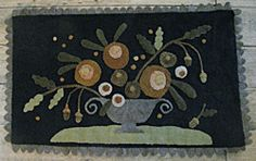 Great wool applique table mat. Country Sampler's Girl Gang Club project.