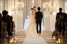 clean modern ceremony decor, candlelit aisle