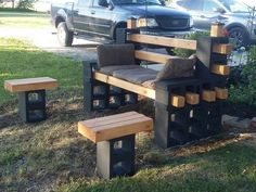 Cinder block bench and tables.  I built the bench using 12 - blocks. Using 8' 4x4s I had some wood left over so I decided to make two small tables. I sealed the 4x4s so they will  last longer. When you stack the blocks use a lock-tite sealant.  This bench will outlast any you can buy in a store and you have bragging rights!