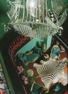 James Coburn's house by Tony Duquette. Zebra skin rug, turquoise silk upholstery and walls, a coral iron railing and a chandelier built around a disco mirror ball. Tony how can you be French baroque, tribal, antique and modern all the same time???? Love you and your era!
