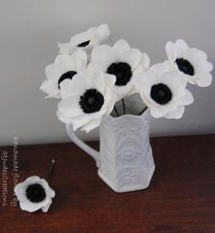 No sure where this pic is from?  White anenome's made in paper.  Nice for black and white centerpieces.