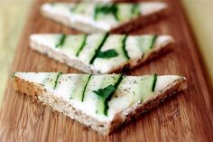 Mmm. Cucumber Tea Sandwiches.  No recipe here, but it is so easy.  Smooth softened cream cheese onto rye bread triangles. Place cucumber slices, parsley on top. Sprinkle with one pkg. of dry Italian dressing mix. Let sit overnight, or as long as you can stand it... these are delicious.  Completely cover the sandwich with cucumber slices...