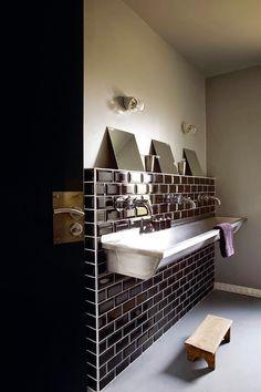 a triple faucet trough sink