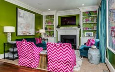 Bold colors and a matching wallpaper at the back of the bookcase!!! Cottage Place | The English Room