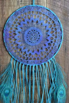 10 Hoop Dream catcher wrapped in an aqua turquoise colored faux suede with a vintage crochet doily that has been hand dyed in turquoise and