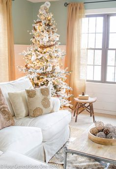 Gorgeous holiday home tour! I love the flocked tree and neutral colors in this room.