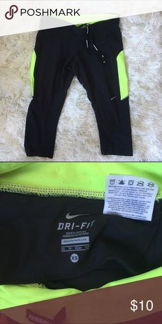 Nike running capris. Black with green detailing. Very lightly worn Nike running capris perfect for working out or running. Size XS. They have a light green stripe down the side. Super comfy. Nike Pants