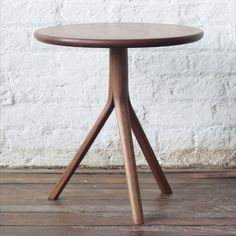 """The T07 is a small side or occasional table in solid walnut. The tripod base structure is formed from three steam bent legs branching out from a central pedestal. The design references the Classic shaker candle stand but with an organic modern take.  Size 1: 17"""" Dia × 17"""" H Size 2: 20"""" Dia × 20"""" H  Hand made to order, solid wood construction. Small Occasional Table, Lewis Furniture, Candle Stand, Organic Modern, Wood Construction, Design Reference, Solid Wood, Stool, Tripod"""