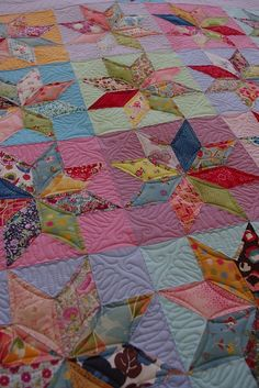 scrappy star quilt... I love the different solid color backgrounds behind the stars!