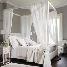 white wood frame bed with white curtains is a great idea to relax and feel peaceful