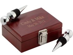 "Double Wine Stopper Wood Box Set Size: 4.6""L x 3.5""W x 1.75H"" A double wine stopper wood box set is a delightful keepsake to symbolize the unity of man and wife. This elegant box set is a special gift that finds favored attention in the home of its recipient. The wine stopper set features two silver wine stoppers with rubberized sides to prevent the flow of liquid even when the bottle is turned upside down - and it fits nicely into most wine bottles including champagne bottles. Both wine…"