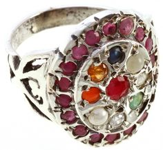 Navaratna Ring - Has ruby, blue sapphire, yellow sapphire, pearl, coral, emerald, cat's eye, diamond, and hessonite.