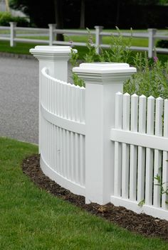 Majestic 8 inch x 8 inch PVC vinyl posts from Illusions Vinyl Fence. No other company has this size available. This is a beautiful entryway with a curved V700-3 Classic Victorian section. #fenceideas #homeideas #backyardideas #fence #posts #backyarddecor