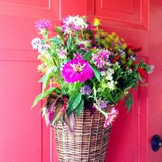 pretty Summer flowers on a pink front door