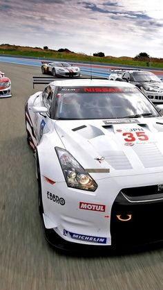 GT-R with other cars on Race Track