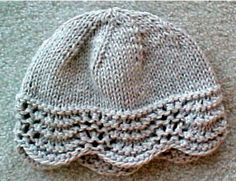 """Fan Stitch Hat - A pretty, lacey, border edge on hat, that is not too difficult to knit. Then on to the top, where it is all stockinette stitch. You finish with a few rounds of decreasing to complete the """"cap"""" look for the hat. IT will not take too much time to knit this. This hat fits most people. Uses bulky weight yarns, knitting needles, US #9, in 16 inch circular form. Also a set of # 9 double points for top of hat.  $2.00"""