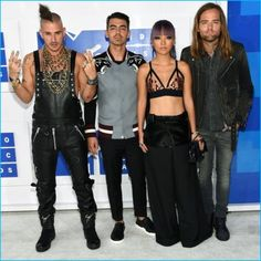 DNCE poses for pictures at the 2016 MTV Video Music Awards with Joe Jonas sporting a look from Valentino.