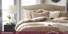 A traditional arabesque pattern scrolls contemporary in a colorful palette of plum, sage green, slate blue, pumpkin and gold on ivory. Printed on cotton by an Italian textile house renowned for its richly colored designs that maintain their brilliance over time.