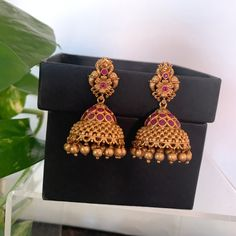 Antique gold finished ruby peacock Jhumkas /Indian jewelry/W Gold Jhumka Earrings, Indian Jewelry Earrings, Jewelry Design Earrings, Gold Earrings Designs, Gold Jewellery Design, Bridal Earrings, Jhumka Designs, Antique Earrings, Necklace Designs