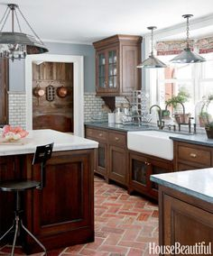 In a New Jersey kitchen, Dan Ruhland installed Parefeuille Peach antique terra-cotta flooring from Exquisite Surfaces.