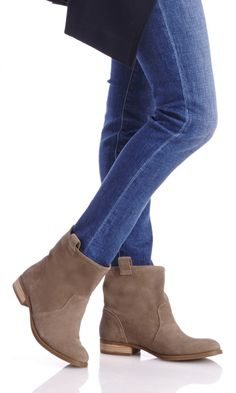Soft suede neutral boots with a slouchy casual shape, pull tabs at the sides, rounded toe and stacked heel
