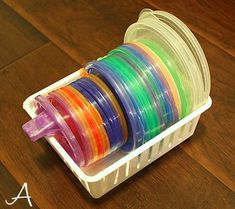 Now this is how to store kids cups or bowl lids, all the lids together, and then all the bottoms together. It might seem like you should keep them with their counterparts, but doing that is a big space waster. Photo from Ask Anna. Tupperware Storage, Tupperware Organizing, Kitchen Cabinet Organization, Organization Hacks, Kitchen Cabinets, Organizing Tips, Organising, Lid Organizer, Organizers