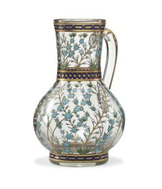 A FRENCH GILT AND ENAMELLED GLASS JUG IN THE IZNIK STYLE  SIGNED POTTIER, NICE, FRANCE, DATED 1885  Of globular form on short flat foot with slightly flaring neck and curving handle, the Iznik-style decoration with swaying prunus branches between floral sprays, with geometric bands above and below, with gilt highlights, signed under the foot in red enamel