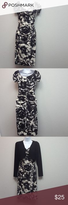 Cocktail dress by American Living Black dress with cream colored flowers. Gathers at the waist with a black long sleeve cover-up. Only worn twice. American Living Dresses Midi