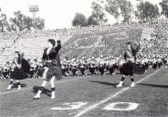 Scottish Highlanders and University of Iowa marching band performing at Rose Bowl, Pasadena, Calif., January 1957.