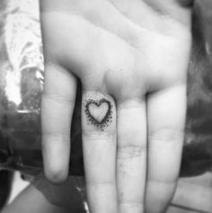 Simple and so very sweet -- love this heart on the ring finger created by tattooist Mel Riner.